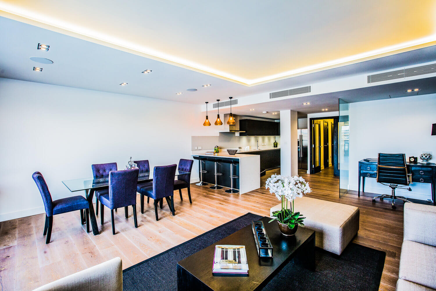 Modern, sleek apartment with bright white LED Strip lighting.