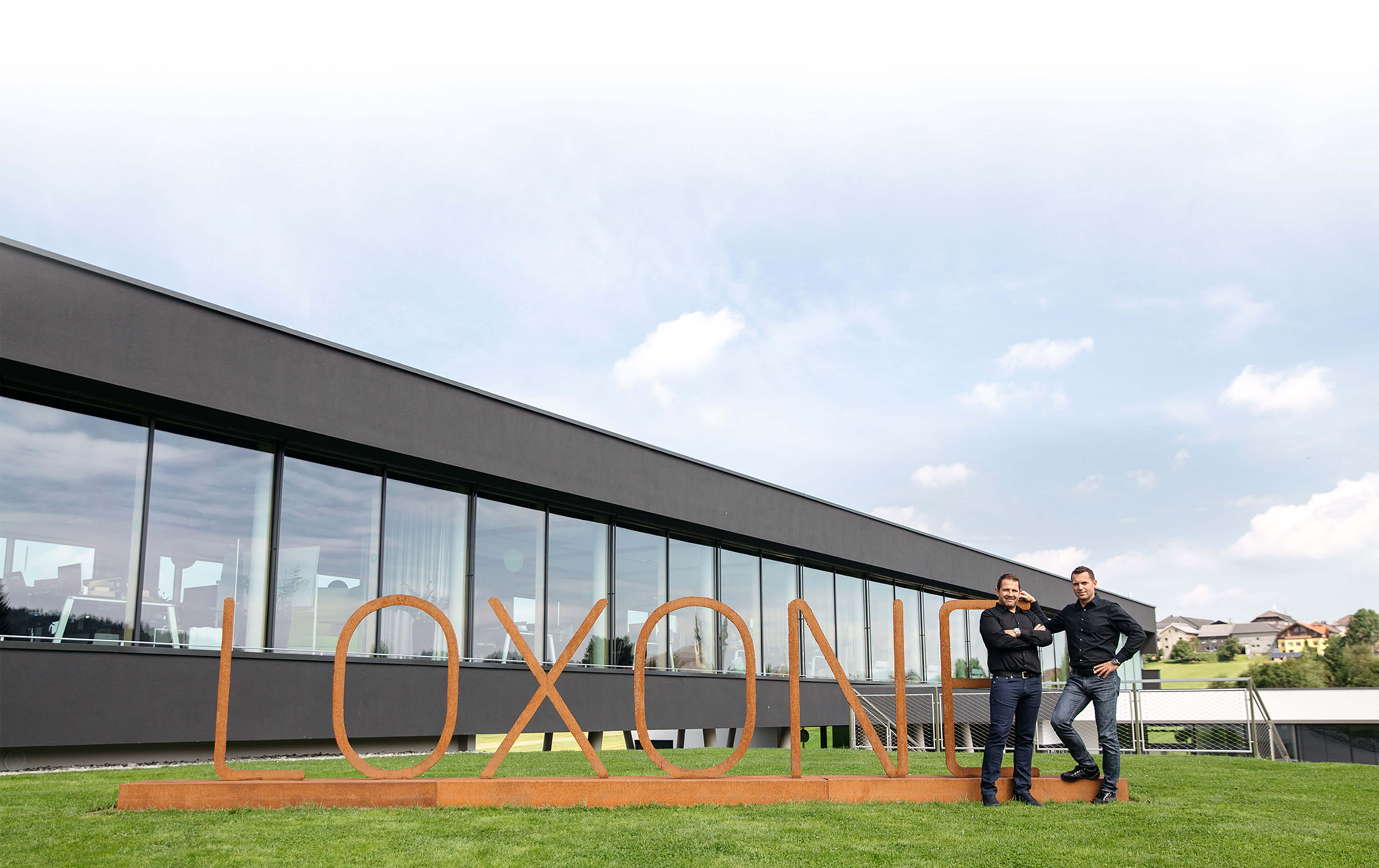 Loxone founders posing outside of global headquarters