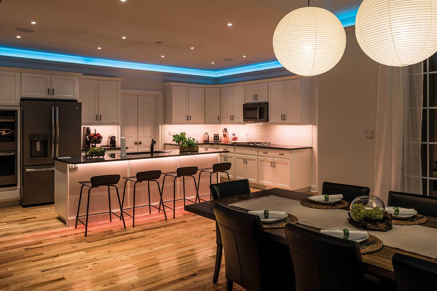 Modern kitchen with bright white lighting and colorful LED Strip accent lighting.