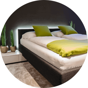 Bed with LED Strip lighting glowing behind headboard