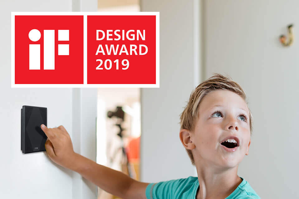 Child using Touch Pure with IF Design Award logo displayed in corner