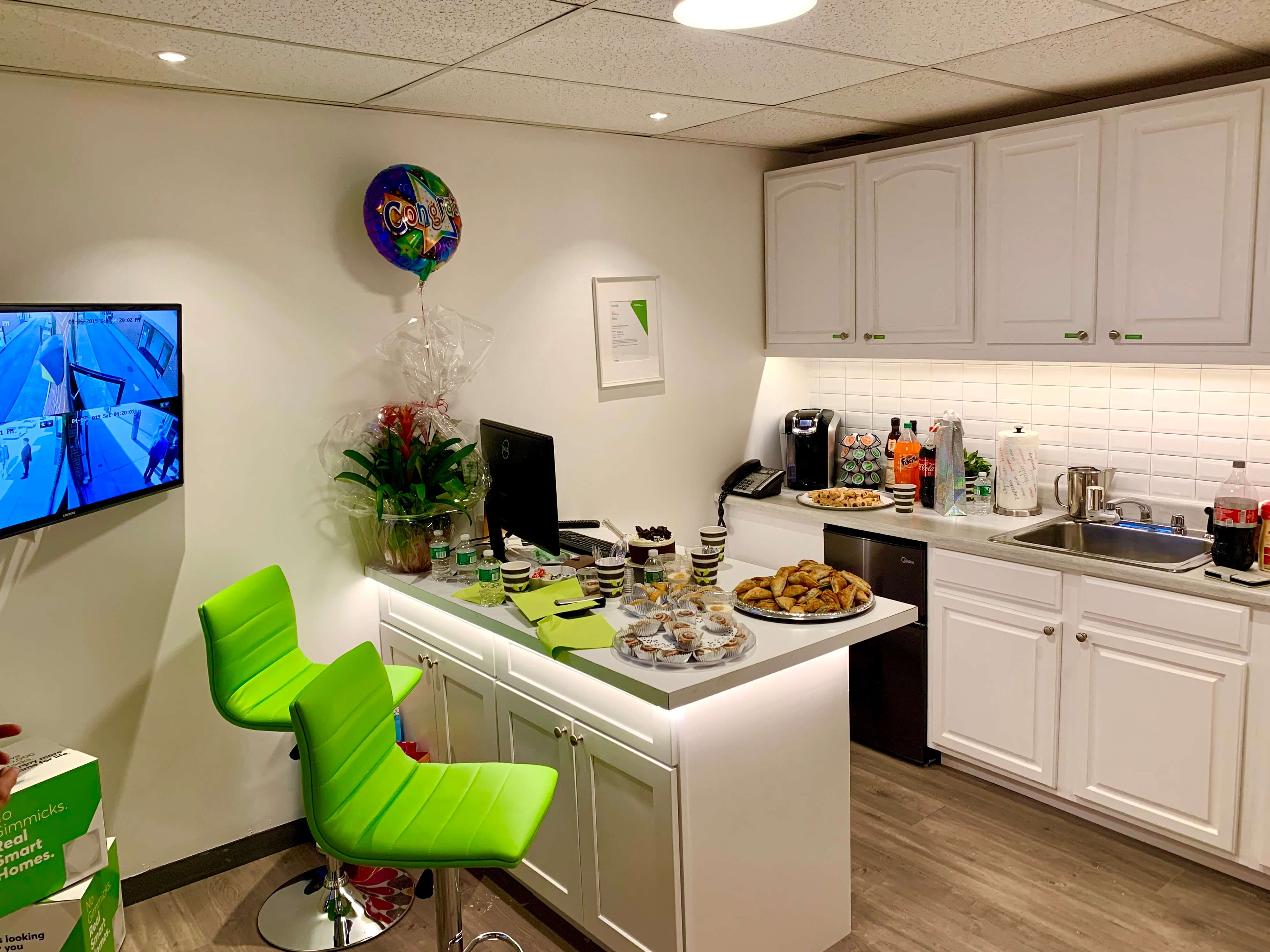 Showroom kitchen with party food spread on counter