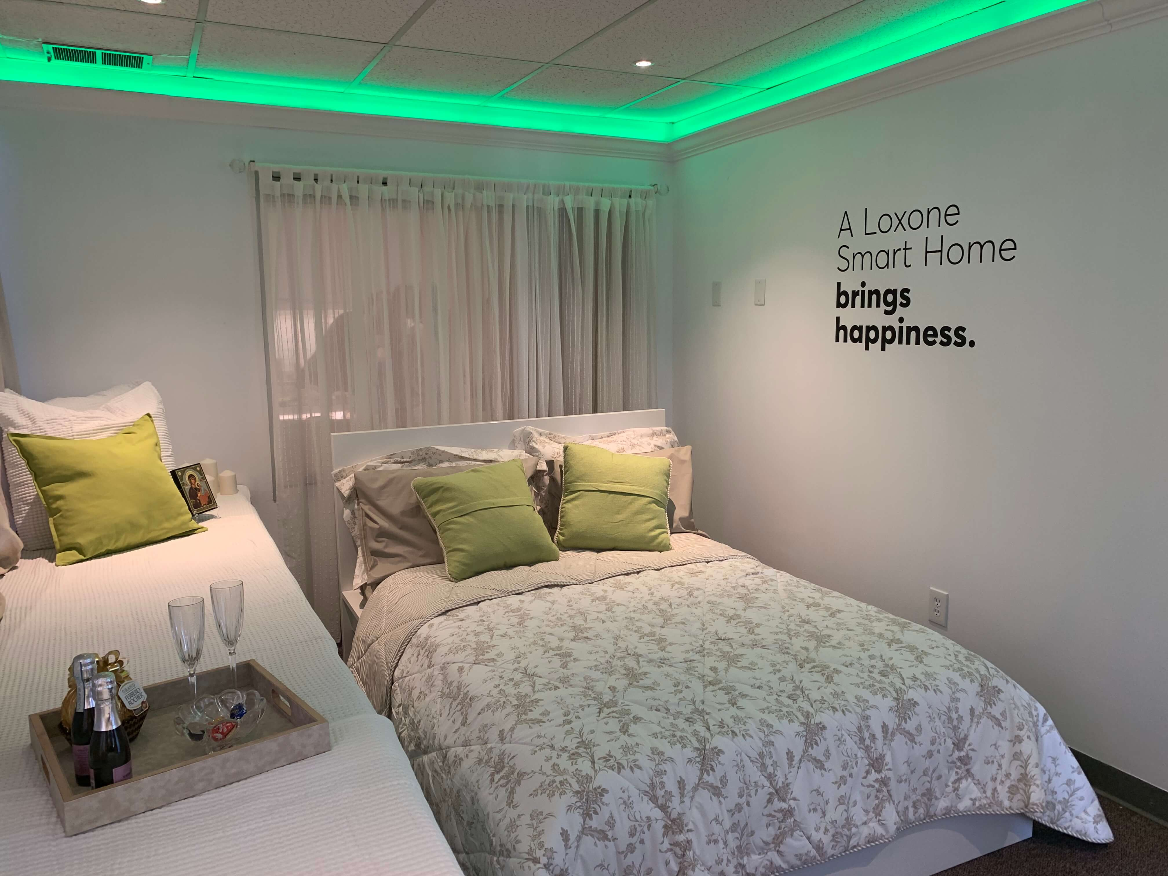 Bedroom with green LED Strip lighting and brunch tray prepared on bedside.