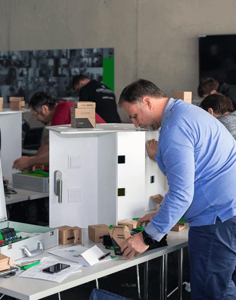 Trainee working on Demo Board installation