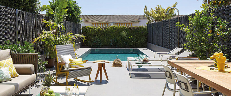 Outdoor living area with pool and plants