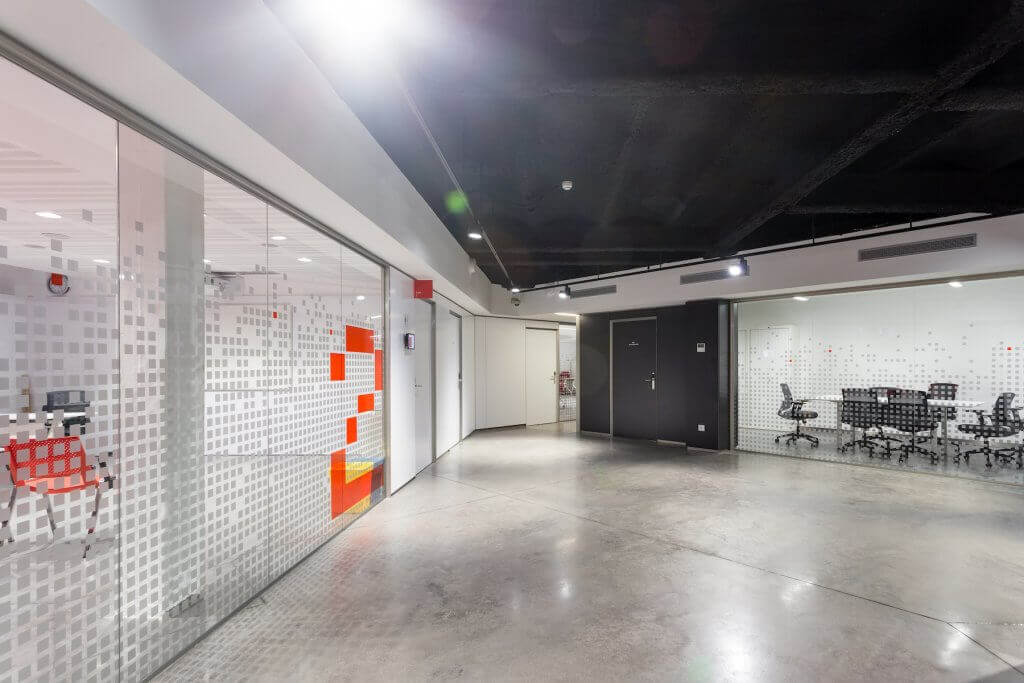Office space with glass wall meeting rooms