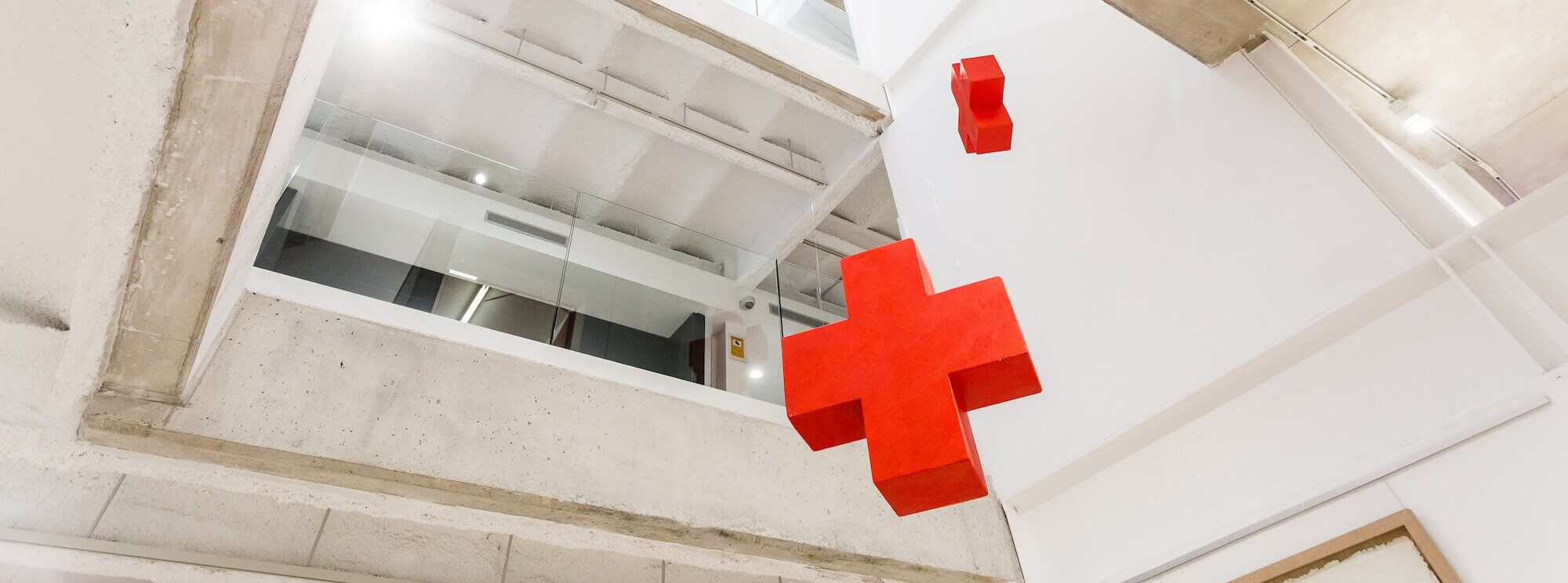 Large open foyer with Red Cross emblem hanging