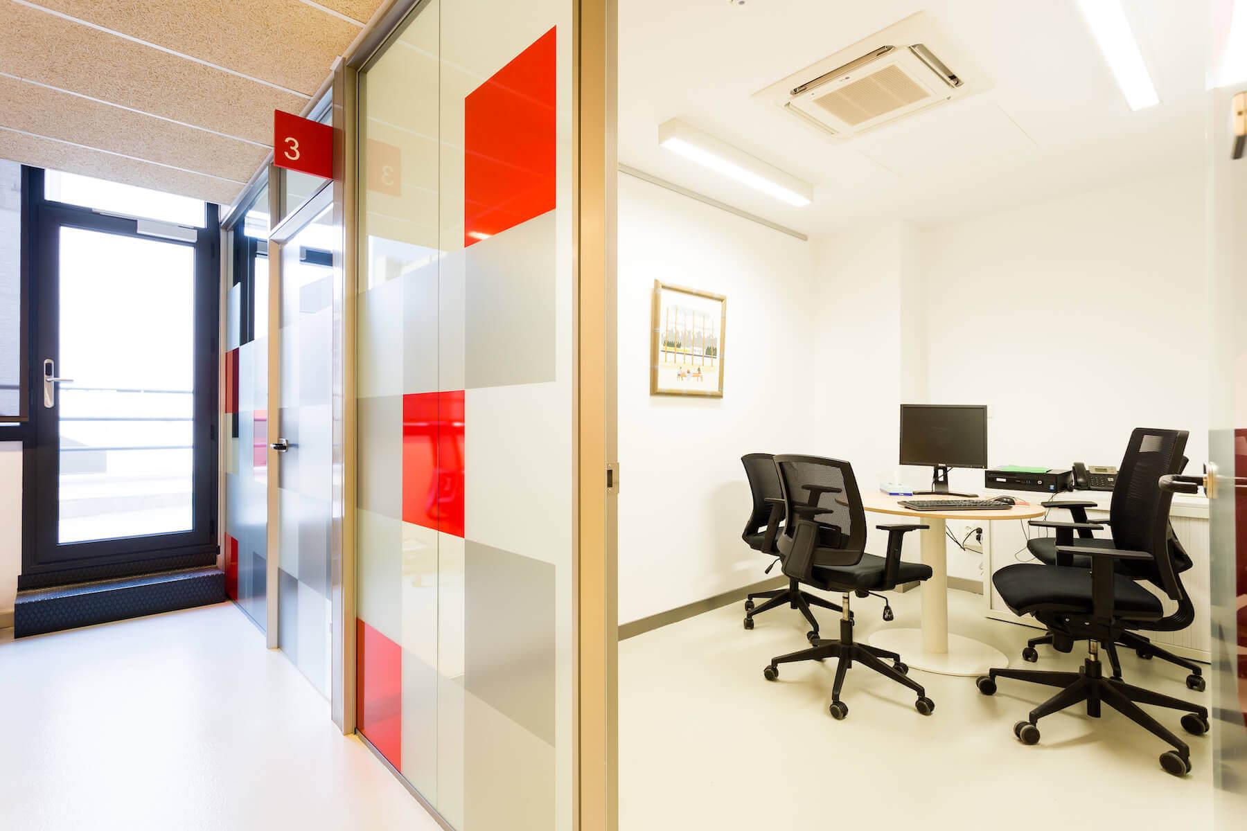 Office meeting room behind glass door