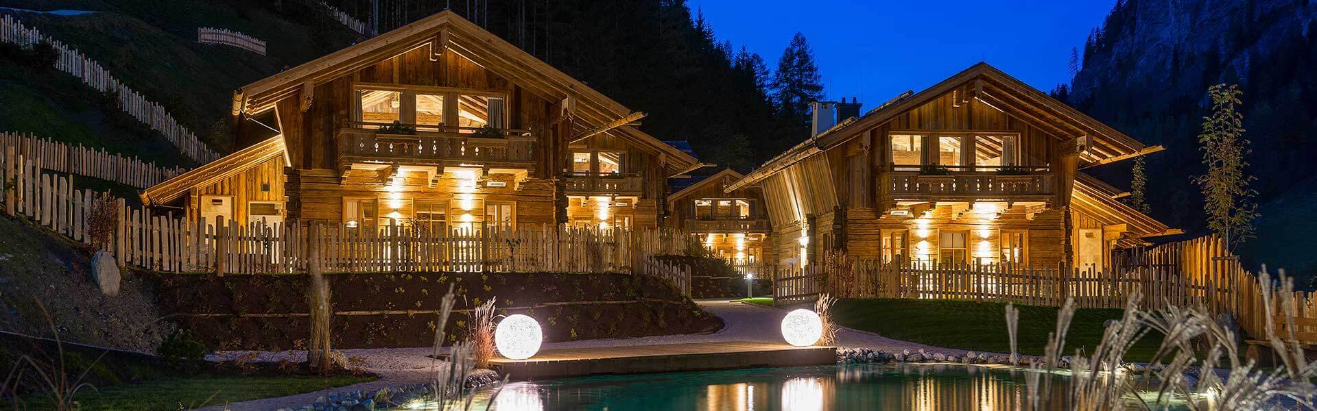 Mountain chalet retreat lit up at night