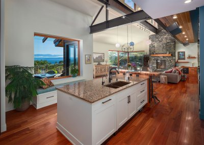 Modern kitchen with wood flooring, island counter and mountain views