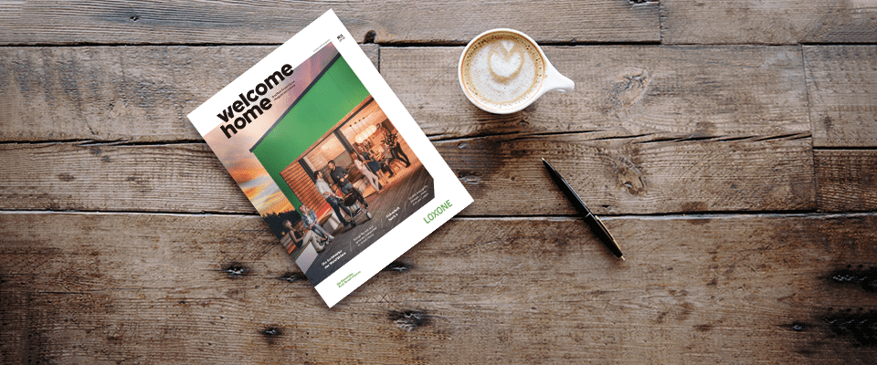 Welcome Home magazine displayed on wood surface with coffee cup