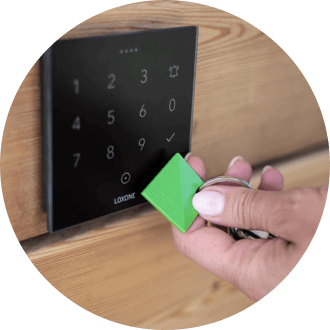 Hand holding NFC Key Fob to NFC Code Touch