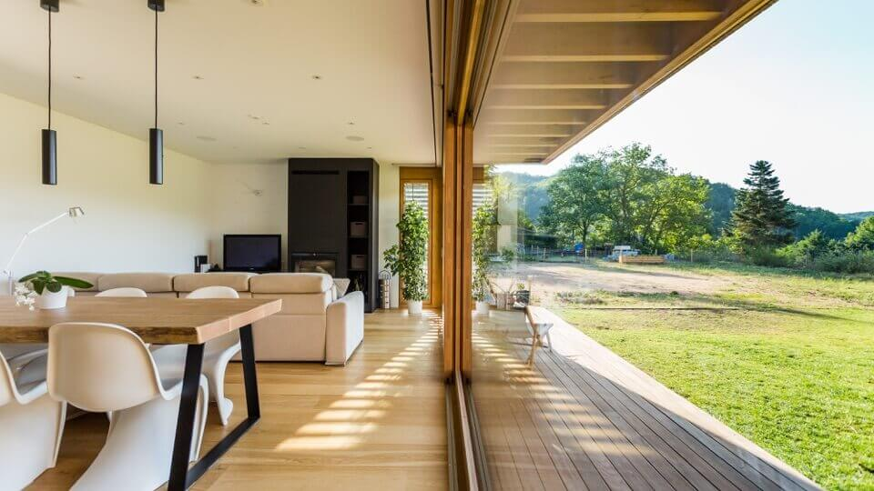 Long glass wall with natural sunlight filling room