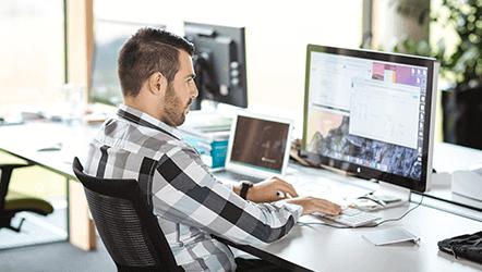 Loxone employee working at desktop