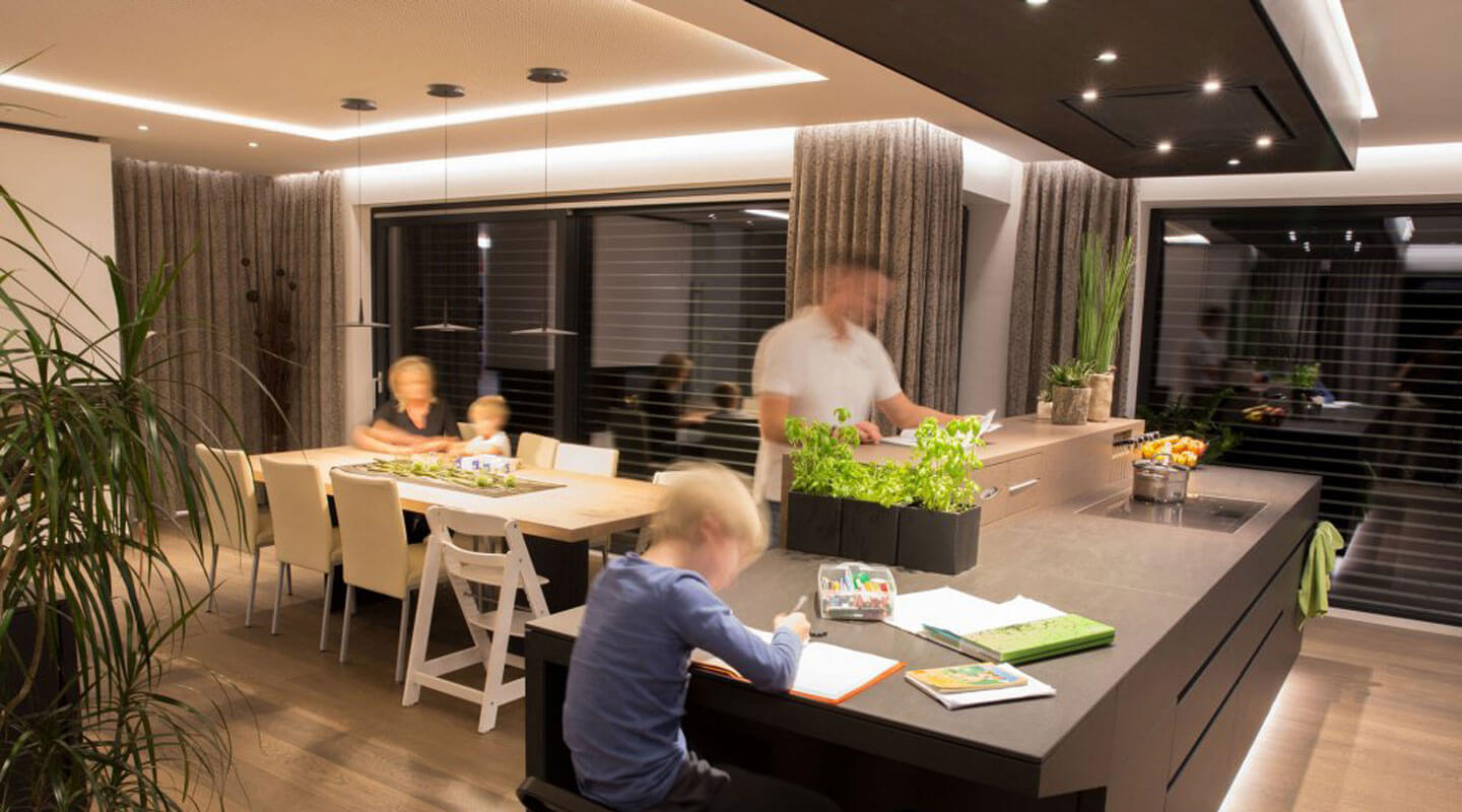 Family in kitchen with bright LED lighting.