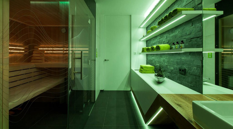 Sauna room with LED Strip lighting along shelves.