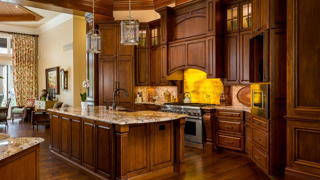 Luxury kitchen with wooden cabinetry and LED lighting effects.