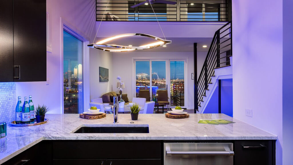 City condo with views enhanced by colorful LED lighting.