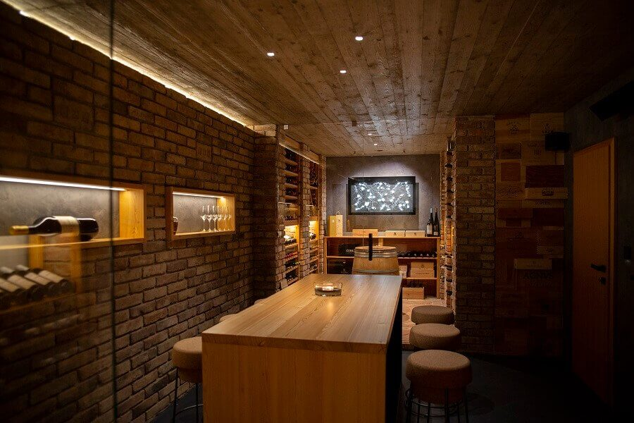 Wine cellar with storage and seating area