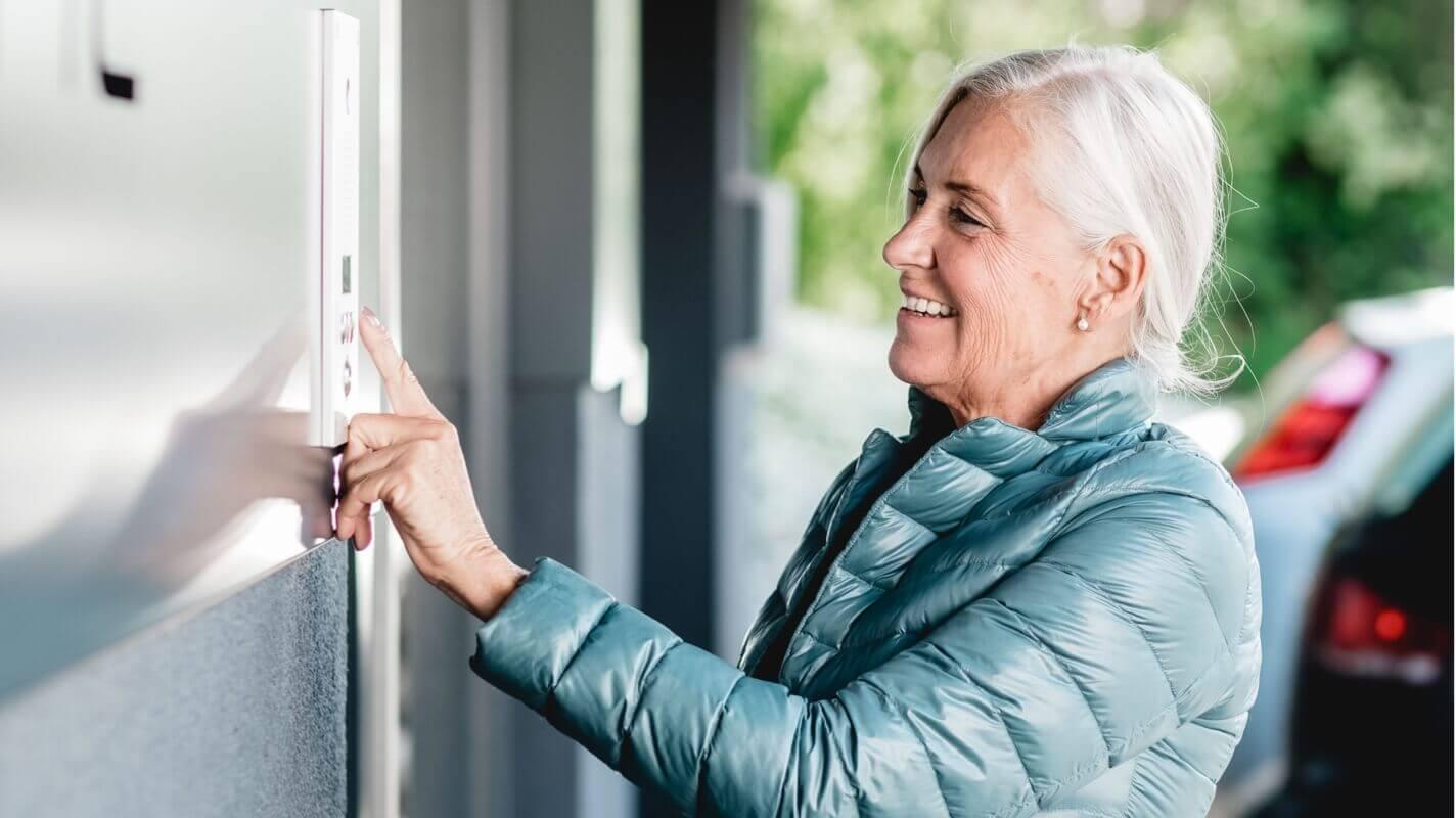 Woman using smart doorbell