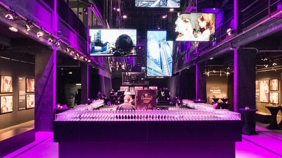Event set-up with purple led lighting around bar area