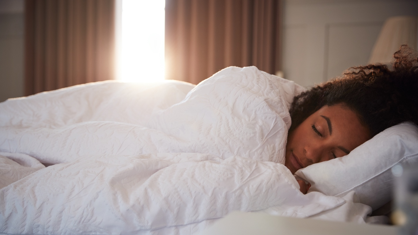 Woman waking up comfortably