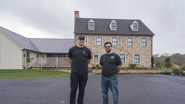 Brent Celek and Loxone Partner Scott Hirst in front of new home