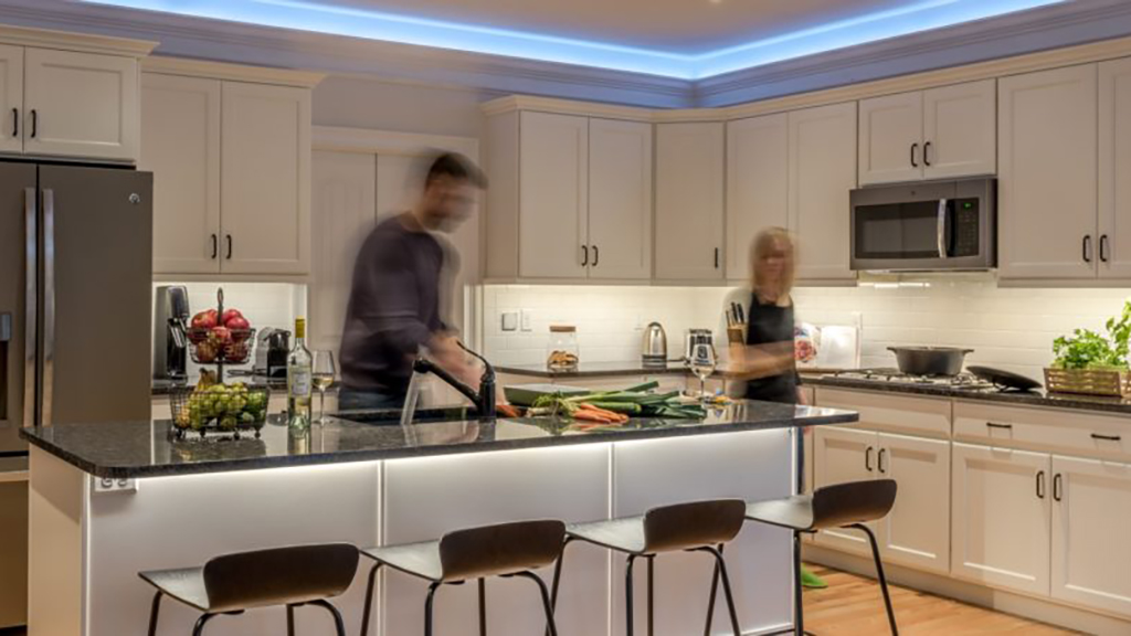 Man in woman cooking in smart home kitchen