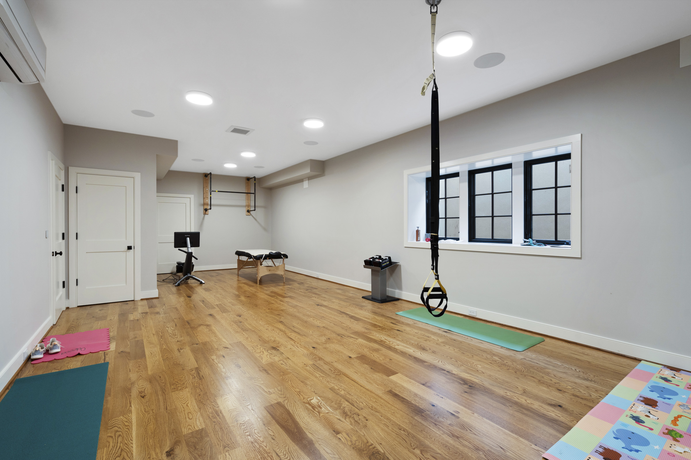 Smart home gym with bright white lighting