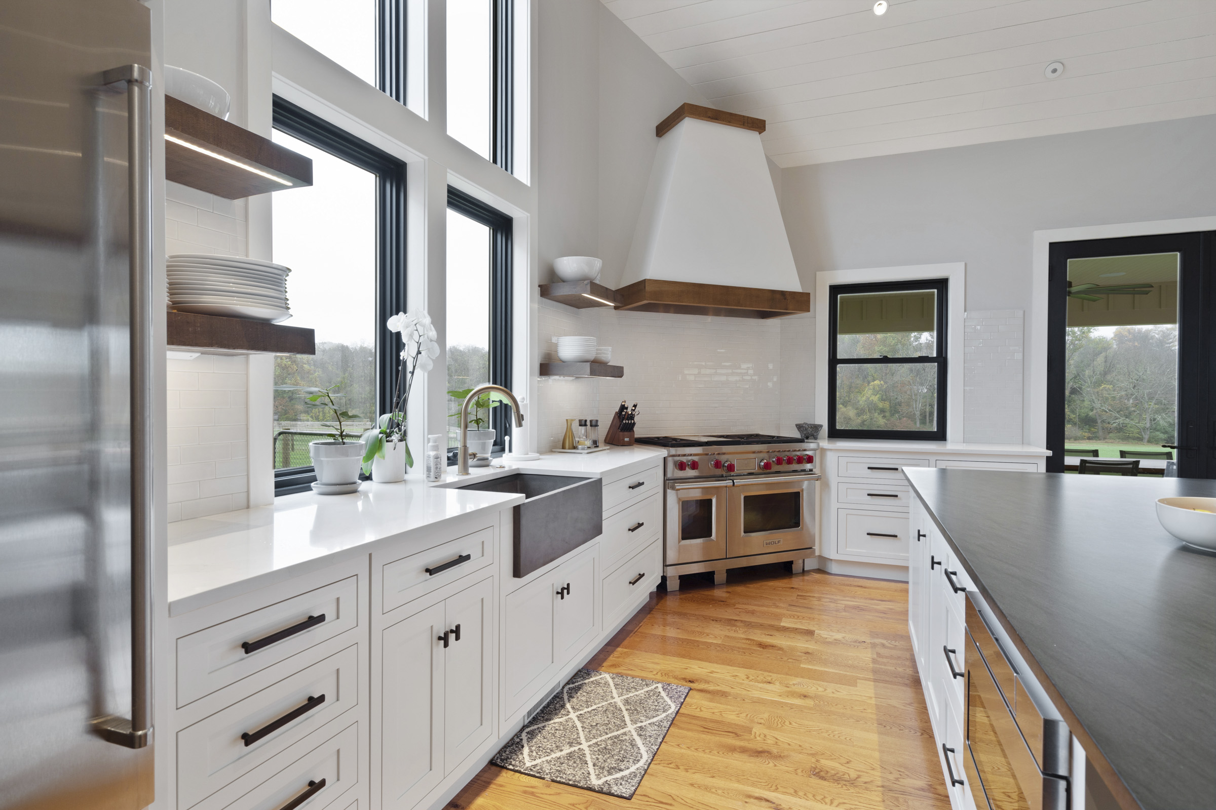 Kitchen with large windows and accent lighting