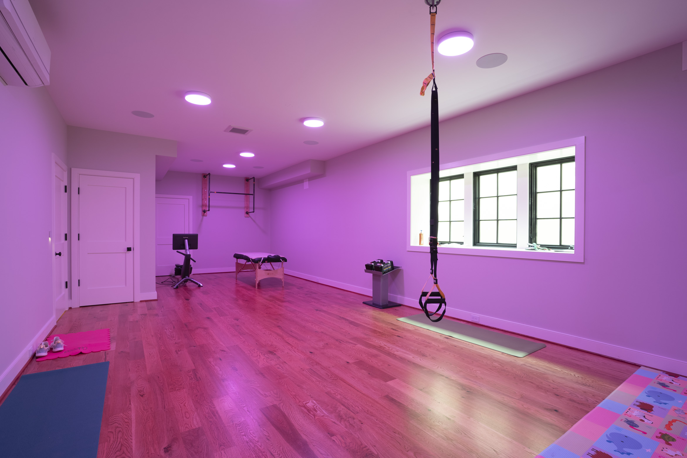 Smart home gym with bright pink lighting